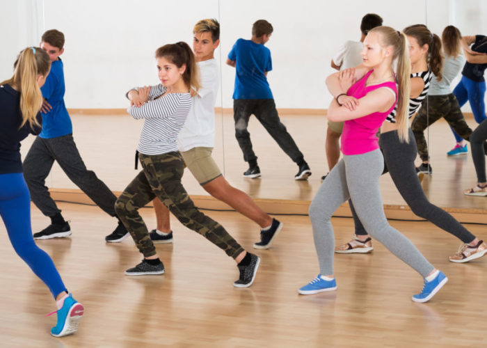 young students having dancing class